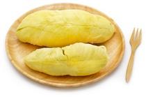 Durian en una placa de madera