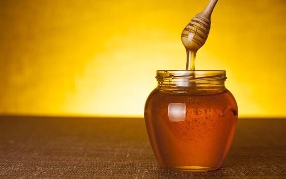 Tarro de miel con cazo