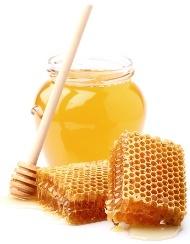 Tarro de miel y peine