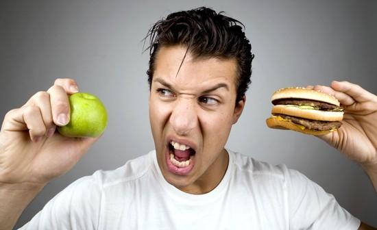 Joven, tenencia, manzana, y, hamburguesa
